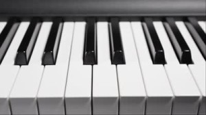cropped-stock-footage-piano-keys-shiny-moving-across-keys-longways.jpg